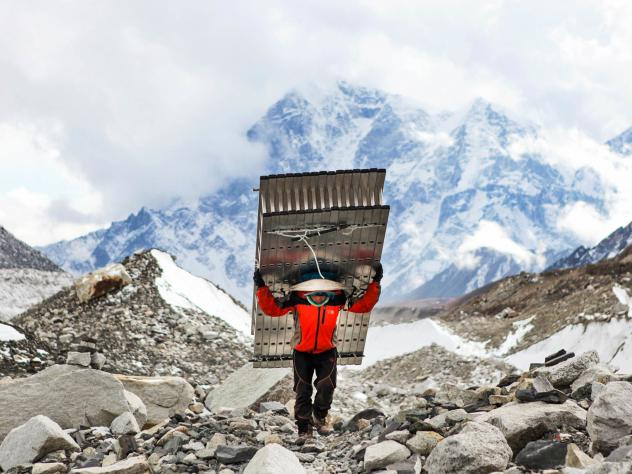 A Sherpa fetches ladders for climbers attempting to summit Mt. Everest.