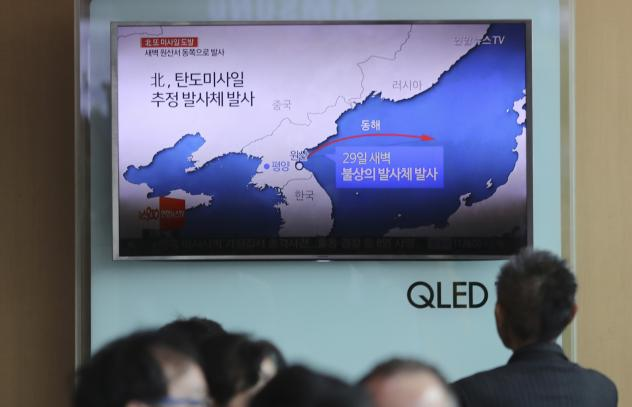The news of North Korea's missile firing is broadcast at Seoul Train Station in South Korea on Monday.