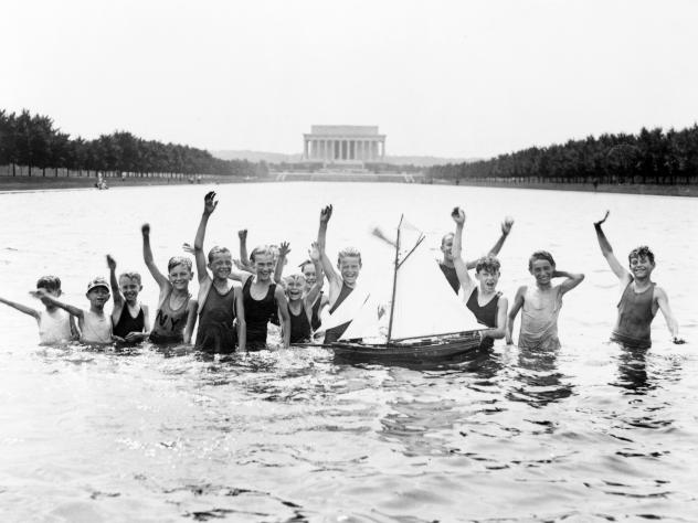 Ducks paddle in the Lincoln Memorial Reflection Pool in better days.