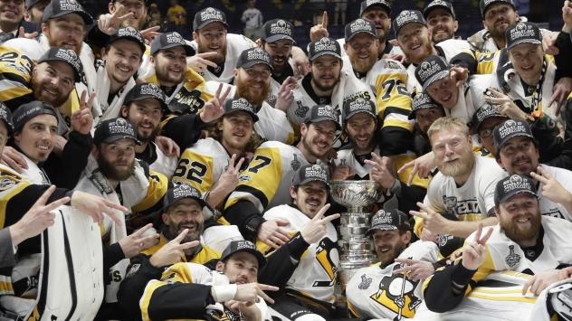 Pittsburgh Penguins' Sidney Crosby (87) kisses the Stanley Cup Sunday after defeating the Nashville Predators in Game 6 of the NHL Stanley Cup Final in Nashville, Tenn.