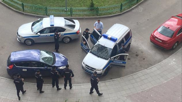 Alexei Navalny is seen being detained by police outside his apartment in Moscow in this photo provided by the Navalny Anti Corruption Fund.