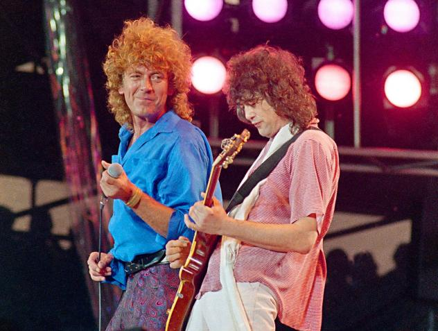 In this July 13, 1985 file photo, Led Zeppelin bandmates, singer Robert Plant, left, and guitarist Jimmy Page, reunite to perform at JFK Stadium in Philadelphia. (Amy Sancetta/AP)