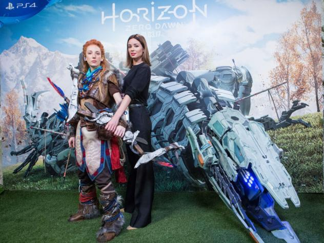 """Cosplayer dressed as Aloy (left) and Spanish actress Dafne Fernandez present the """"Horizon: Zero Dawn"""" video game on Feb. 15 in Madrid, Spain."""