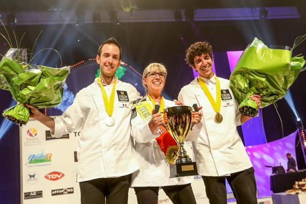 Ten international cheesemongers competed to be named the best cheesemonger in the world at Mondial du Fromage. Nathalie Vanhaver, from Belgium, in center, took gold. Christophe Gonzalez, from France, on the left, won silver; and for the first time ever,