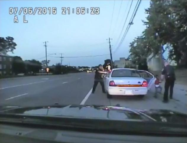 In this image made from July 6, 2016, video captured by a camera in the squad car of St. Anthony Police officer Jeronimo Yanez, the Minnesota police officer is shown after shooting into the vehicle at Philando Castile during a traffic stop in Falcon Heig