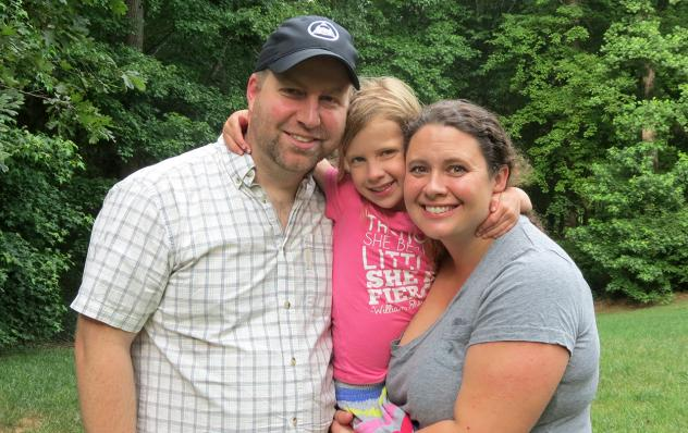 Clara Hardy (middle) with her parents, Robert and Chrissy. Clara, who lives in North Carolina, needed expensive surgery and other procedures right after birth to save her life. The family's insurance policy paid most of the cost.