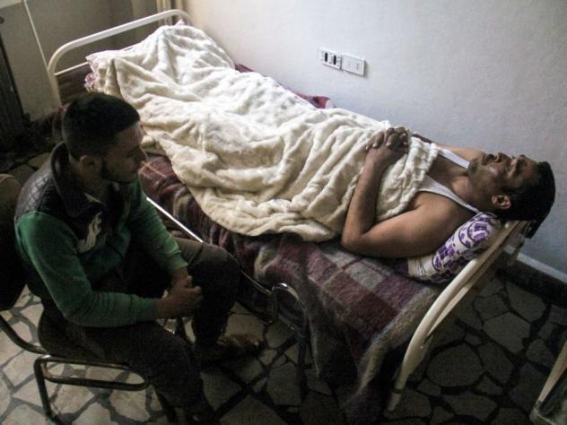 Hassan Youssef, a 40-year-old victim of the April 4 chemical attack in Khan Shaykun, receives medical care in a hospital in the nearby Syrian city of Idlib in April.