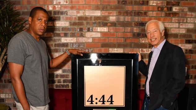 Shawn Carter, aka Jay-Z, left, with Recording Industry Association of America chairman and CEO Cary Sherman, accepting a platinum certification plaque for <em>4:44</em>.