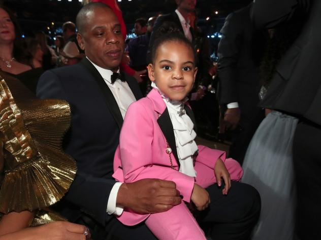 Blue Ivy Carter sits on her father, Jay-Z's lap at The 59th Grammy Awards