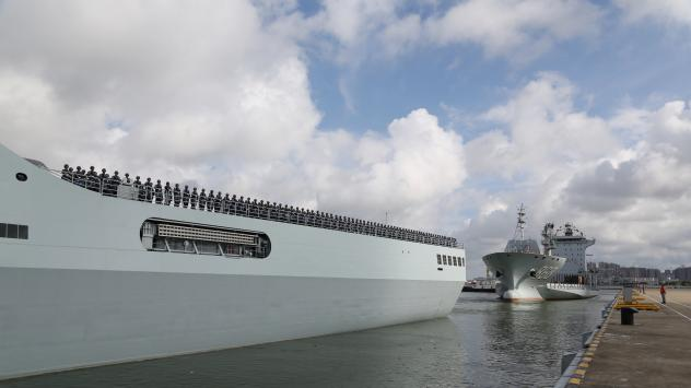 In this photo released by China's Xinhua News Agency, ships carrying Chinese military personnel depart a port in Zhanjiang. The country dispatched members of its military to Djibouti on Tuesday to man its first overseas military base.