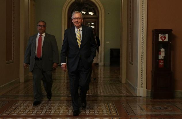 Senate Majority Leader Sen. Mitch McConnell, R-Ky., on his to his office on Thursday at the Capitol in Washington, D.C.