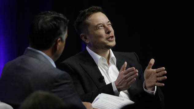 Tesla and SpaceX CEO Elon Musk responds to a question by Nevada Republican Gov. Brian Sandoval during the third day of the National Governors Association's meeting on Saturday in Providence, R.I. Among other things, Musk warned governors that artificial