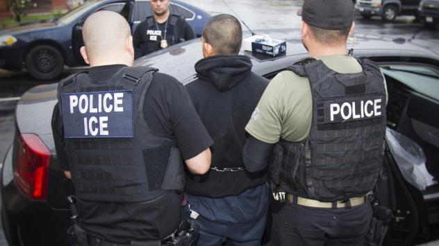 "In this February photo released by U.S. Immigration and Customs Enforcement, agents arrest foreign nationals. According to a Massachusetts Supreme Judicial Court ruling Monday, local law enforcement cannot honor ICE ""detainers,"" which request that a pers"