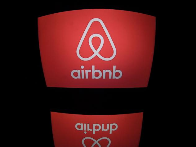 Airbnb's logo displayed on a computer screen in Paris