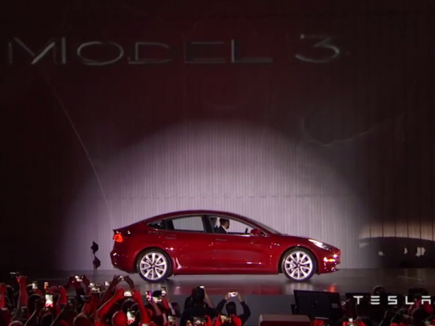 Tesla CEO Elon Musk arrives in the company's new Model 3 electric vehicle for a special event on Friday.