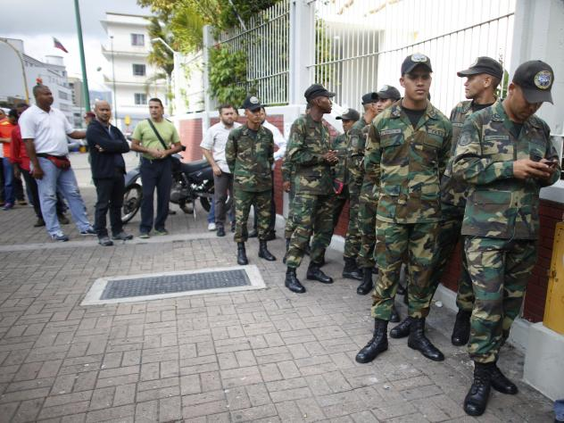Venezuelan Bolivarian Army soldiers lineup to vote on the creation of a new assembly on Sunday.