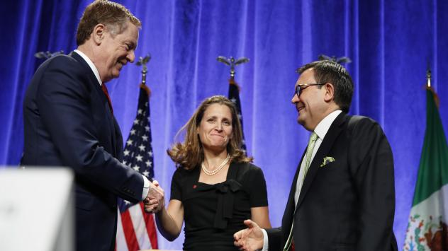 U.S. Trade Representative Robert Lighthizer (left) shakes hands with Canadian Foreign Affairs Minister Chrystia Freeland, accompanied by Mexico's Secretary of Economy Ildefonso Guajardo, after they spoke at a news conference Wednesday at the start of NAF