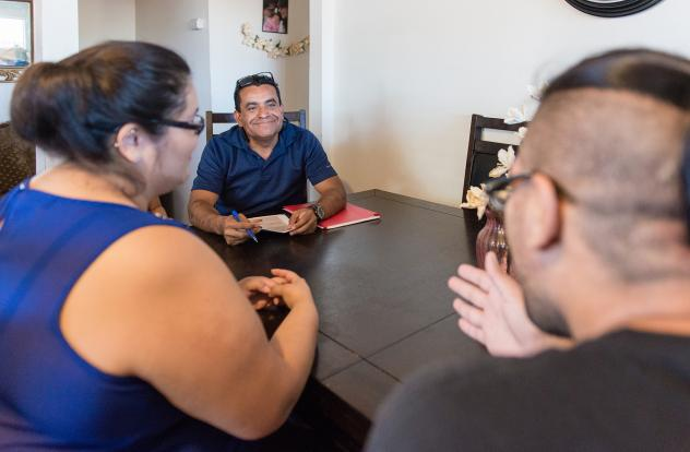 Rosendo Gil, who was a nurse in his native Mexico, works to build trust with all of his clients. Blas Lopez and Lluvia Padilla say Gil has taught them how to better care for their daughter and themselves.