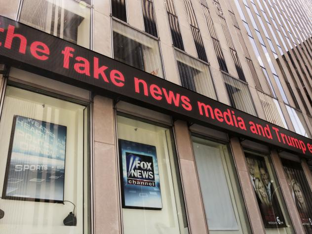 Fox News ceased broadcasting in the UK on Tuesday. Its parent company, 21st Century Fox, is trying to get government approval for its takeover bid of European media giant Sky. Above, headlines scroll across the Fox News studios in New York earlier this m