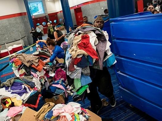 Volunteers sort through donated clothing at a shelter in the George R. Brown Convention Center during the aftermath of Hurricane Harvey on August 28 in Houston, Texas.