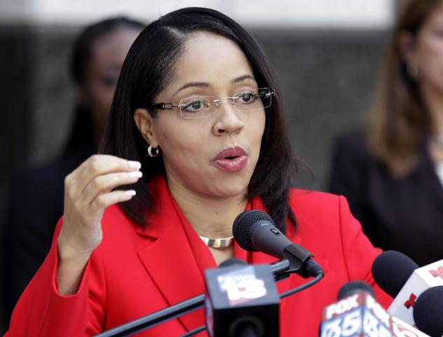 Florida State Attorney Aramis Ayala answers questions during a news conference Friday in Orlando, Fla.