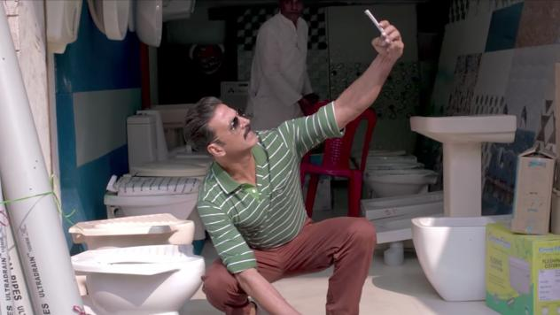 This selfie is in the toilet: Actor Akshay Kumar poses with the object of his bride's affection in the new movie 'Toilet: A Love Story.'
