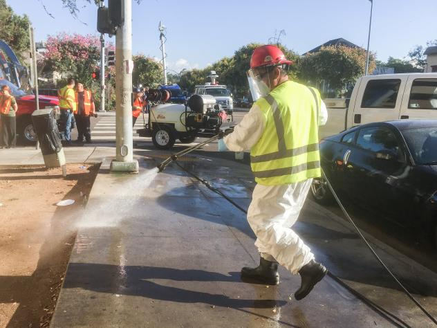 City workers wash down streets and sidewalks Monday in an effort to control a hepatitis A outbreak in San Diego.