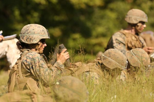 Marines participate in an exercise during the Infantry Officer Course in August at Quantico, Va. The first female Marine to complete the course graduated on Monday.