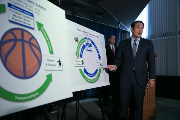 Acting U.S. Attorney Joon H. Kim speaks during a press conference at the U.S. Attorney's Office, Southern District of New York today. The acting U.S. Attorney announced Federal criminal charges against ten people, including four college basketball coache