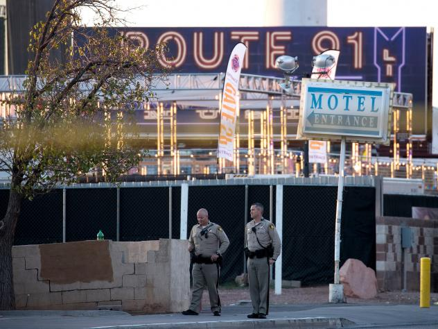 Law enforcement officers stand guard at one of the entrance points to the Las Vegas concert venue where Sunday night's mass shooting took place. The massacre was one of the deadliest mass shooting events in modern U.S. history.