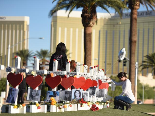 Fifty-eight white crosses for the victims of the shooting on the Las Vegas Strip earlier this month are arrayed Oct. 6 just south of the Mandalay Bay hotel. The shooter fired down on a crowd of concertgoers from a room in the hotel, and on Thursday its p