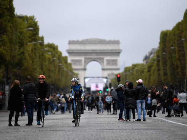 "Mayor Anne Hidalgo has called for an end to gas-powered vehicles in Paris by 2030, in favor of biking, transit, and electric cars. Here, cyclists and pedestrians on the Champs- Élysées during the city's ""day without cars"" on Oct. 1."