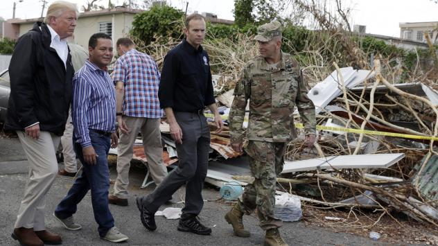 President Trump walks with FEMA administrator Brock Long, second from right, and Lt. Gen. Jeff Buchanan, right as he tours an area affected by Hurricane Maria in Guaynabo, Puerto Rico, on Oct. 3.
