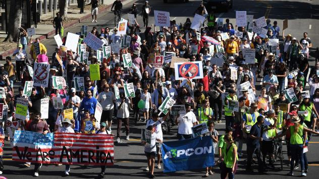 """People marching in the """"#NoMuslimBanEver"""" rally in downtown Los Angeles on Sunday. Organized by the Council on American-Islamic Relations, the march was in response to President Trump's most recent travel ban, which has now been partially blocked by a fe"""