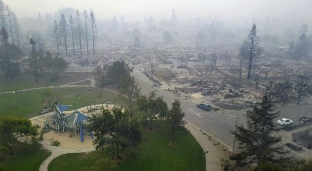 In Santa Rosa, a playground stands across the street from where recent wildfires reduced homes to rubble.