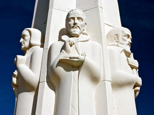 The Astronomers Monument in Griffith Observatory, Griffith Park, Los Angeles, Calif. shows Johannes Kepler in the center flanked by Isaac Newton, on the left and Galileo Galilei on the right.