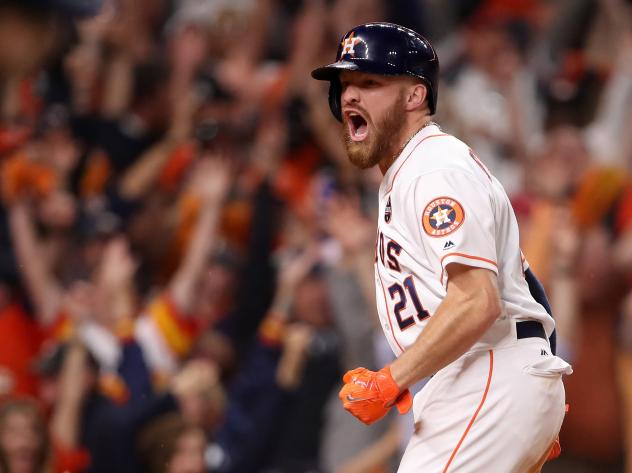 Derek Fisher of the Houston Astros celebrates after scoring the winning run during the 10th inning against the Los Angeles Dodgers in Game 5 of the World Series.