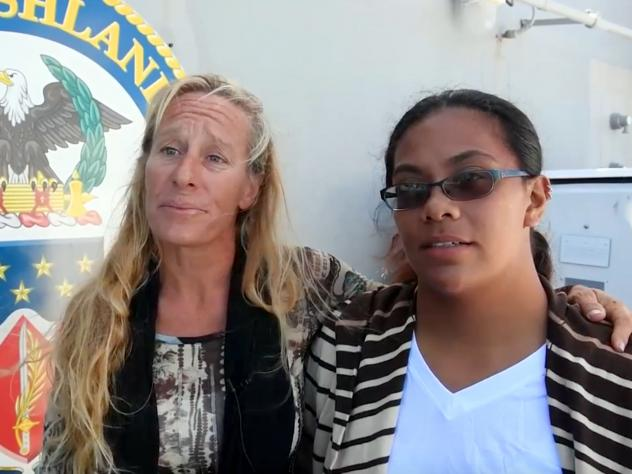 Jennifer Appel (left) and Tasha Fuiava are interviewed aboard the <em>USS Ashland</em> in the South Pacific on Oct. 25. They were rescued after reportedly drifting for months while trying to sail from Hawaii to Tahiti.