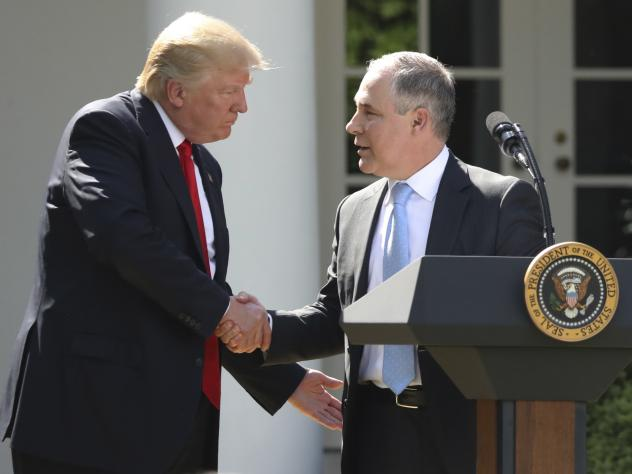 President Donald Trump shakes hands with EPA chief Scott Pruitt on June 1 after speaking about the U.S. role in the Paris climate change accord in the Rose Garden of the White House in Washington.