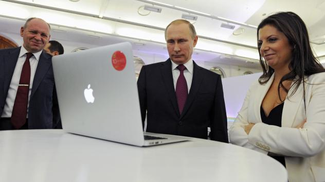 RT Editor-in-Chief Margarita Simonyan is seen with Russian President Vladimir Putin and Kremlin's first deputy chief of staff, Alexei Gromov, as they marked RT's 10th anniversary in Moscow in 2015.