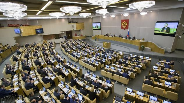 Russian lawmakers in the State Duma applaud after voting Wednesday to allow the government to register international media outlets as foreign agents.