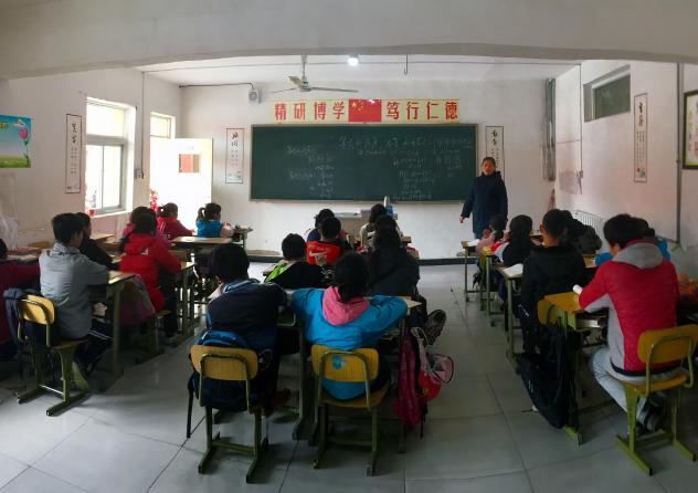 Children whose parents have migrated from elsewhere in China sit in a classroom at a private school in Beijing. They are officially still citizens€ of the rural areas their families come from and not eligible for public education elsewhere.