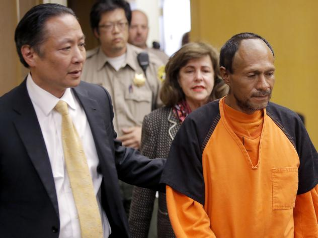 Jose Ines Garcia Zarate enters a  San Francisco courtroom led by Public Defender Jeff Adachi for his arraignment in 2015.