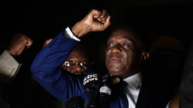 Zimbabwe's incoming president Emmerson Mnangagwa gestures as he speaks at Zimbabwe's ruling ZANU-PF party headquarters in Harare, Zimbabwe, on Wednesday. The former vice president flew home from a short exile to take power after the resignation of Robert
