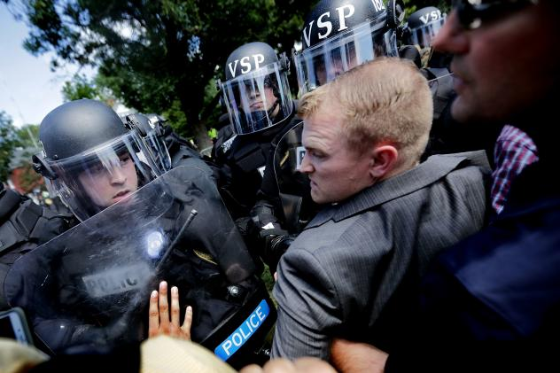 """White nationalists clash with police as they are forced out of Emancipation Park after the """"Unite the Right"""" rally Aug. 12 in Charlottesville, Va."""