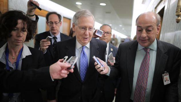 Senate Majority Leader Mitch McConnell talks with reporters after leaving a news conference on the tax overhaul in the Dirksen Senate Office Building on Capitol Hill.