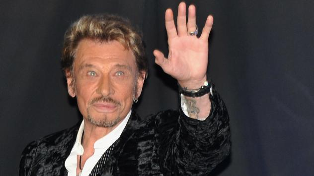 Johnny Hallyday waves to his fans during his album launch celebration in Paris in 2011.