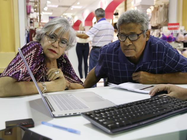 Isabel Diaz Tinoco and Jose Luis Tinoco had some questions for the Miami insurance agent who helped guide them in signing up for a HealthCare.gov policy at the Mall of the Americas in November.