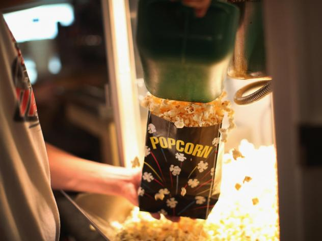 Dillon Smith gets popcorn for customers in the concession stand at the TK/Starlite Drive-In Theater in Nebraska.