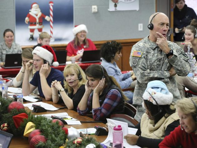 U.S. Northern Command Chief of Staff Maj. Gen. Charles D. Luckey joins volunteers taking phone calls from children during the annual NORAD Tracks Santa Operation, at the North American Aerospace Defense Command, at Peterson Air Force Base, Colo. Photo ta